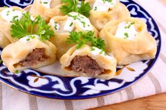 Stuffed dumplings, manti of dough and minced Stock Photos
