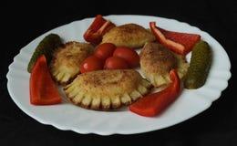 Stuffed dumplings smoked meat and garnish Stock Image