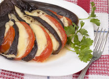 Stuffed eggplant. Stuffed eggplant with cheese and tomatoes on a plate Stock Photo
