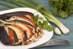 Stuffed eggplant. Stuffed eggplant with cheese and tomatoes on a plate Royalty Free Stock Photo
