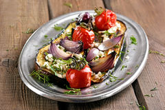 Stuffed eggplant with fried vegetables Royalty Free Stock Photo
