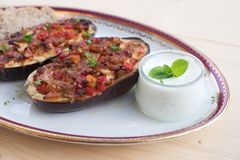 Stuffed Eggplant halves with tomato onion sweet pepper and cheese. Royalty Free Stock Images