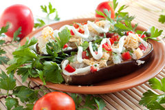 Stuffed Eggplant On A Round Brown Plate Stock Photo