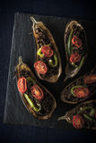 Stuffed eggplants  with vegetables on the dark stone top view Royalty Free Stock Image
