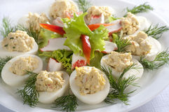 Stuffed eggs. Eggs stuffed with crab sticks Royalty Free Stock Photo