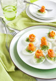 Stuffed eggs with avocado filling and smoked salmon Royalty Free Stock Image