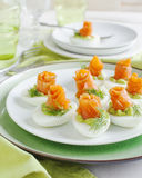 Stuffed eggs with avocado filling and smoked salmon Royalty Free Stock Photos