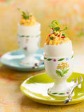 Stuffed eggs in egg cups Stock Photography