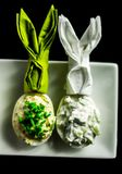 Stuffed eggs with hand-made filling and bunny napkin, healthy an. D tasty snack, easter Stock Photos