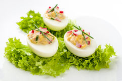Stuffed eggs. On lettuce with chives garnish stock image