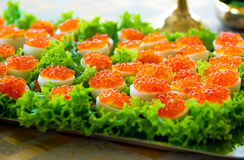 Stuffed eggs with red caviar Stock Photo