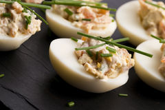Stuffed eggs with salmon Stock Photos
