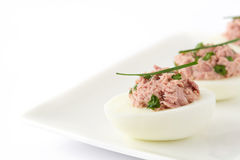 Stuffed eggs with tuna isolated. On white background Royalty Free Stock Photos