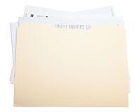 Stuffed file folder. A brown folder  stuffed isolated in white background Stock Photography