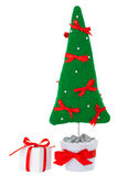 Stuffed fir tree toy in flowerpot with gift box Royalty Free Stock Photography