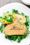 Stuffed fish on plate Royalty Free Stock Photography