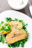 Stuffed fish on plate Stock Images