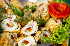 Stuffed fish rolls dish. Plate of elegant dish of fish rolls stuffed with paprika and fried in pancake pastry Royalty Free Stock Photos