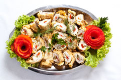 Stuffed fish rolls dish. Plate of elegant dish of fish rolls stuffed with paprika and fried in pancake pastry Stock Image
