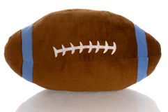 Stuffed football. Stuffed toy football with reflection on white background Stock Images