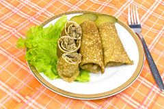 Stuffed fried pancakes with meat . Stuffed fried pancakes with meat, lettuce and cucumbers stock photos