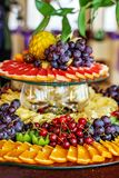 Stuffed fruit with oranges, kiwis, grapes, cherries and pineapples. The concept of healthy food and vegetarian. royalty free stock photography
