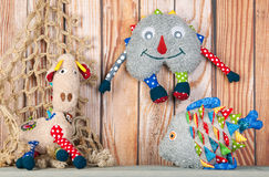 Stuffed funny toys on wooden background Royalty Free Stock Photography