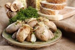 Stuffed garlic champignon Stock Images