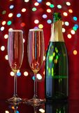 Stuffed glasses with champagne with nearby bottle open Stock Photo