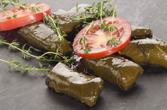 Stuffed grape leaves on slate Royalty Free Stock Photo