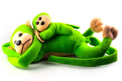 Stuffed green monkey mother and child. Royalty Free Stock Photography