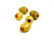 Stuffed green olives. Green Greek olives stuffed with red bell pepper Stock Photography
