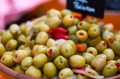 Stuffed Green Olives. A bowl of freshly prepared pepper-stuffed green olives. Mediterranean style royalty free stock photo