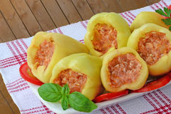 Stuffed green peppers uncooked. Bell peppers stuffed with minced meat and rice, ready to be cooked Royalty Free Stock Images