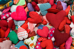 Stuffed hearts. A background of colorful studded hearts Stock Photo