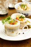 Stuffed herrings rollmops. With gherkins, onion and herbs Stock Image