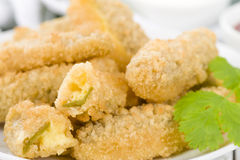 Stuffed Jalapenos. Green chilies filled with cheese, breaded and deep fried Stock Photo