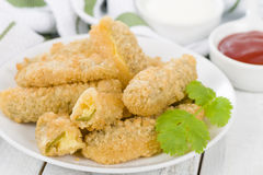 Stuffed Jalapenos. Green chilies filled with cheese, breaded and deep fried Royalty Free Stock Photo