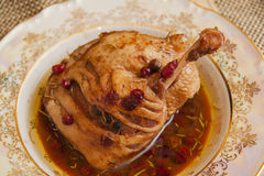 Stuffed leg of duck with berries Royalty Free Stock Images