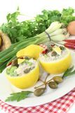 Stuffed Lemons with tuna cream, capers and eggs Stock Photo
