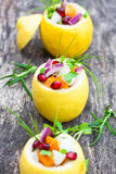 Stuffed lemons with vegetarian salad on the old table Stock Photography