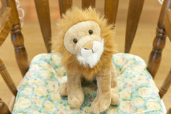 Stuffed lion toy in chair stock image