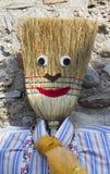 Stuffed man with broom Royalty Free Stock Photos