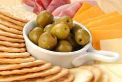 Stuffed Manzanilla Olives and Crackers. A snack plate with pimiento stuffed green olives and crackers Royalty Free Stock Photography