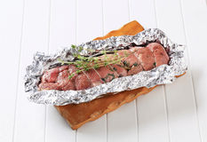 Stuffed meat roulade. In tinfoil Royalty Free Stock Image