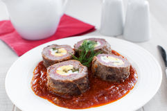 Stuffed meat roulade with eggs, salami Stock Photos