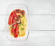 Stuffed with minced red bell pepper with mashed potatoes in transparent rectangular Bowl Royalty Free Stock Photo