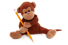Stuffed Monkey With Pencil Drawing. Over White Background Royalty Free Stock Photography