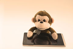 Stuffed monkey with a vintage phone Stock Photo