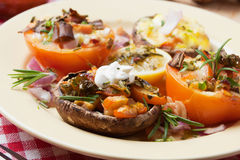 Stuffed mushroom and tomato Stock Images